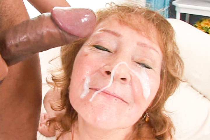 Exotic looking mature whore get cum on her eager face