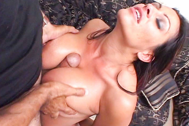 Lubing his dick with saliva and putting it between her tits