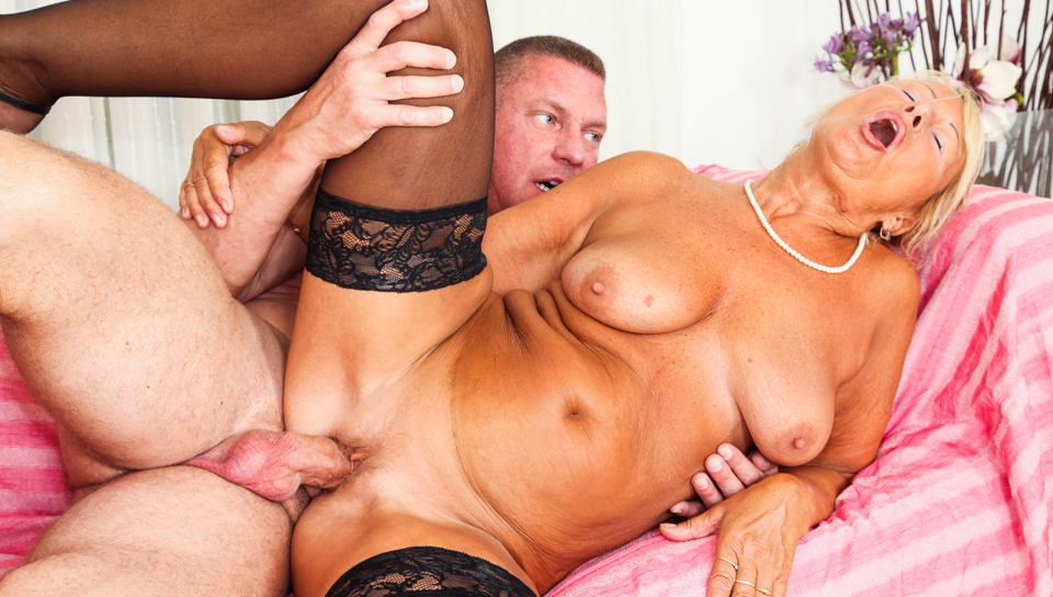 Sexy blonde granny Regi fucks with young lover