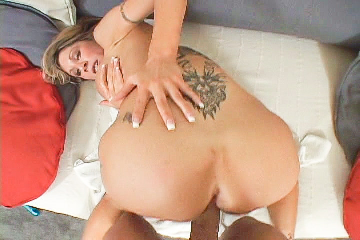 Slutty blonde with back tattoo rides dick in reverse cowgirl