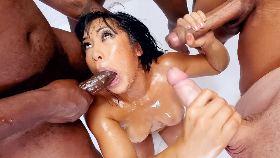 Wet food 07 scene 03. Pretty, playful Asian Mia Li poses in gorgeous bikini undies and heels. She kneels, surrounded by 10 erections, black and white, for an interracial circle suck. Mia strokes boners and gives lip-smackin' head, with slobber running from her happy smile to her tan-lined tits and all over her tight body. The dudes grip her head for face fuck and Mia laps scrotum. Lube is squirted down her throat and cock-smeared all over her face. Spit coats her face in an upside-down suc bang. Mia begs for cum and laughs as she's facialed by 10 spunky loads. She sucs semen bubbles, her eyes reddened, hair soaked, false lashes unglued. And Mia shows cultural appreciation, comparing the mess on her face to the abstract painting of Jackson Pollack!