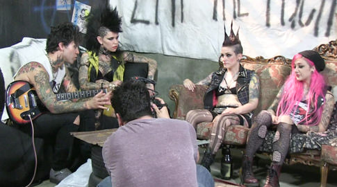 Bts episode 70 joanna angel rizzo ford small hands vera drake kelsi lynn amelia dire. We went behind the scenes of our latest Burning Angel feature STREET PUNXXX and looked over some kick booty footage. Small Hands gets busy and then we find sweetheart Vera Drake and talk about her spectacular walk-on roll in the movie. We catch up with mohawk-ed 'crust punk' Rizzo Ford and discuss her combat boots and all the action they've seen in porn - and then everyone with a mohawk sits on the couch. Alice 'Malice' McMunn makes a special appearance as well, and you can catch a glimpse of Kelsi Lynn, Amelia Dire and the rest of the gang massive at work moshing.